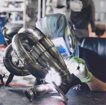 picture man man welding headers.